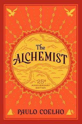 The Alchemist by Paulo Coelho book cover, a golden sun motif on orange background