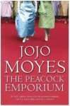 Old Cover of The Peacock Emporium by Jojo Moyes shows woman dressed for a ball